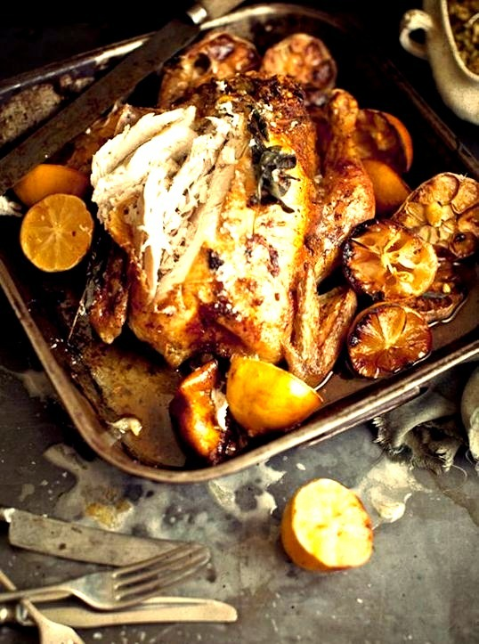 Garlic Butter Roast Chicken with Lemon, Nut and Bacon StuffingSource
